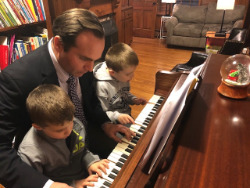 Charlie at piano with children.