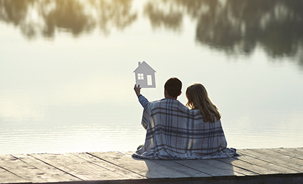 couple sitting on dock on a lake