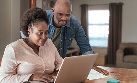African-American couple making an online payment