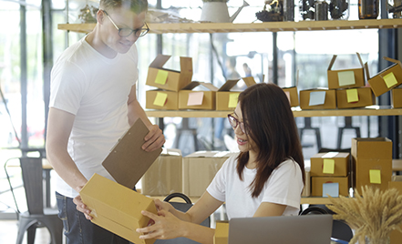 man and woman in store looking at box